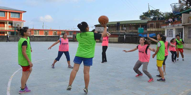 Playing Basketball match between students from France and Lower TCV